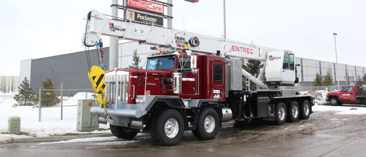This is a beautiful example of a tandem tridem Kenworth C550 picker truck that we build and sell here at Edmonton Kenworth. This particular truck has been out fitted with a 45 ton 100 foot boom Hydra-Lift crane.