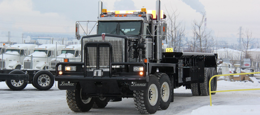 "One of the bigger Kenworth C550 bed trucks we sell! It is a 440"" bed and is equipped with a Braden HP 160 main winch and a Tulsa RN 80 secondary winch. The bed is over 7 feet off the ground! This thing is a monster!"