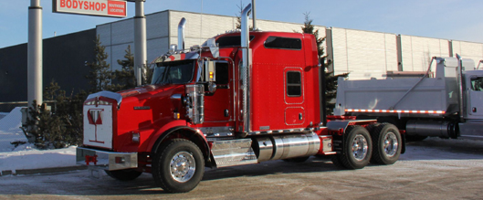 This is an example of a heavy haul Kenworth T800 tractor. This truck features a wide hood to accomodate a larger radiator for more cooling capacity when hauling heavy loads. It also sports Kenworth's huge Studio Sleeper!